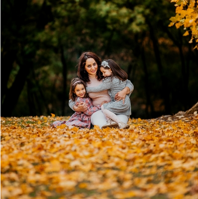 Mummy and Daughters with Autumn Leaves